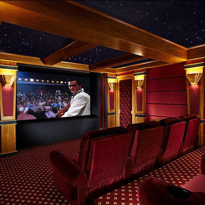 Large elegant enclosed carpeted and red floor home theater photo in New York with red walls and a projector screen