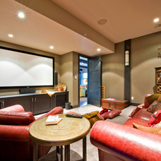 Rustic Home Theater by Lipsett Photography Group