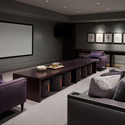 Example of a trendy carpeted and gray floor home theater design in Chicago with gray walls