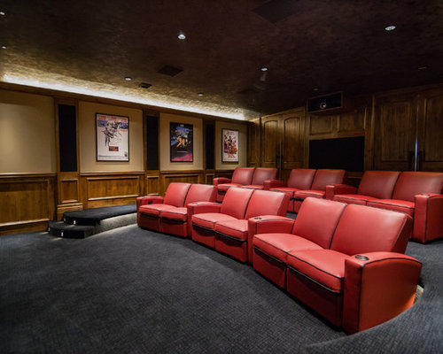 Example Of A Mountain Style Enclosed Carpeted And Gray Floor Home Theater  Design In Wichita With