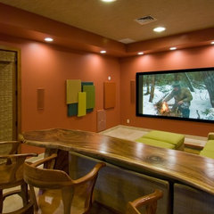 tropical media room by Archipelago Hawaii, refined island designs