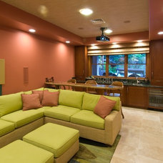 Tropical Home Theater by Archipelago Hawaii Luxury Home Designs
