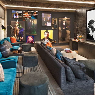 Mountain style enclosed carpeted and gray floor home theater photo in Other with gray walls and a projector screen