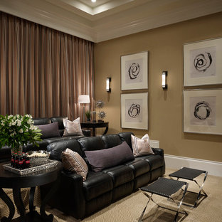 Inspiration for a transitional enclosed carpeted home theater remodel in Miami with brown walls