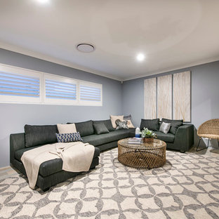 Large beach style enclosed home theatre in Perth with grey walls, vinyl floors and a wall-mounted tv.