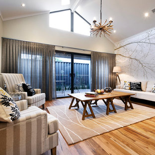 Design ideas for a mid-sized open concept home theatre in Perth with grey walls and vinyl floors.