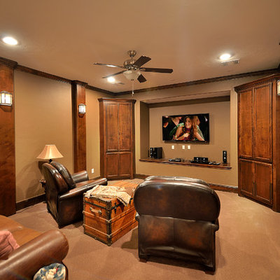Example of a mid-sized arts and crafts enclosed carpeted home theater design in Phoenix with brown walls and a wall-mounted tv