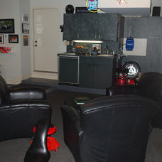 Eclectic Home Theater by The Garage Slab