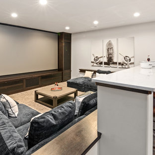 Inspiration for a large farmhouse brown floor home theater remodel in Cincinnati with gray walls and a media wall