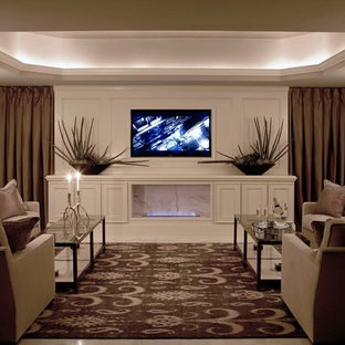 Photo of a large traditional enclosed home theatre in Atlanta with multi-coloured walls, vinyl floors and a built-in media wall.