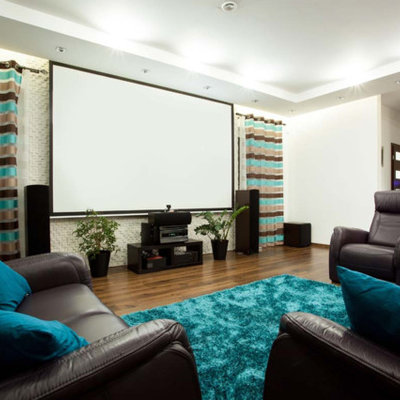 Example of a large trendy enclosed medium tone wood floor and brown floor home theater design in San Francisco with white walls and a projector screen