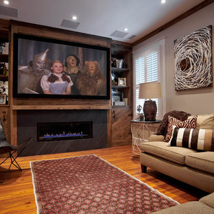 Example of an eclectic home theater design in Charlotte