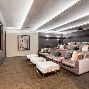 Design ideas for an expansive traditional enclosed home cinema in Las Vegas with multi-coloured walls, carpet, a projector screen and brown floors.