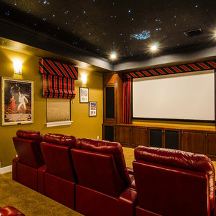 Inspiration for a large timeless enclosed carpeted and brown floor home theater remodel in Tampa with a projector screen and brown walls