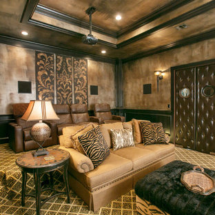 Inspiration for a mediterranean enclosed carpeted and multicolored floor home theater remodel in New Orleans with a projector screen