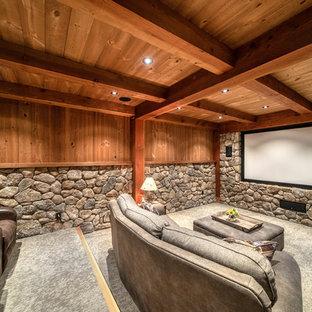 Ejemplo de cine en casa rural con paredes marrones, moqueta, pantalla de proyección y suelo gris