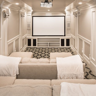 Home theater - traditional enclosed carpeted and black floor home theater idea in Salt Lake City with beige walls and a projector screen