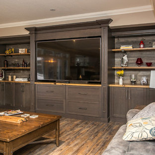 This is an example of a large country open concept home theatre in Toronto with grey walls, vinyl floors, a built-in media wall and brown floor.
