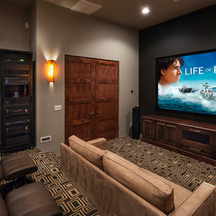 Inspiration for a timeless multicolored floor home theater remodel in Phoenix with a projector screen
