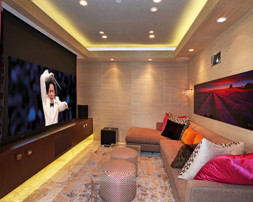 Small Contemporary Home Theatre In Orange County With A Projector Screen.