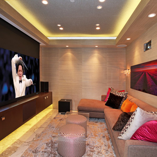 Example Of A Small Trendy Home Theater Design In Orange County With Projector Screen
