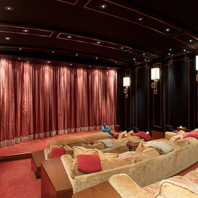 Home theater - huge traditional enclosed carpeted and red floor home theater idea in Vancouver with black walls and a projector screen