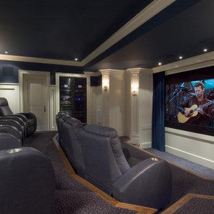 Foto di un home theatre chic con pareti blu e pavimento blu