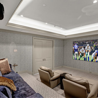 Home theater - traditional enclosed carpeted and beige floor home theater idea in Dallas with gray walls and a projector screen