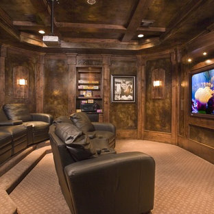 Home theater - traditional brown floor home theater idea in Houston with a projector screen