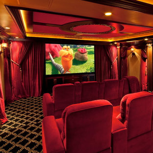 Home theater - traditional carpeted home theater idea in Los Angeles