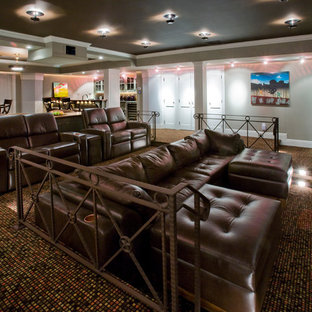 Home theater - traditional multicolored floor home theater idea in New York
