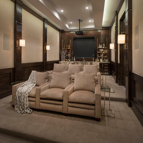 mid sized transitional enclosed home theater idea in dallas with beige