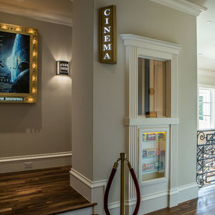 Inspiration for a transitional home theatre in Dallas with medium hardwood floors.