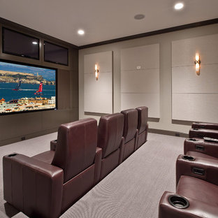 Transitional gray floor home theater photo in Seattle with a projector screen
