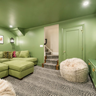 This is an example of a mid-sized traditional enclosed home theatre in San Francisco with green walls, carpet, a wall-mounted tv and grey floor.