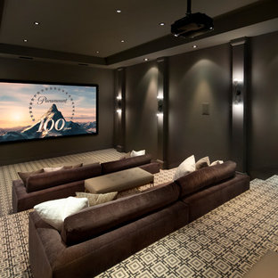 Photo of a modern home theatre in San Francisco with grey walls, carpet, a projector screen and beige floor.