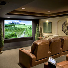 Mediterranean Home Theater by Stone+Glidden, Inc