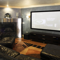 Mediterranean Home Theater by Barenz Builders