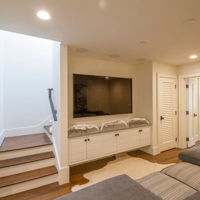 Home theater - mid-sized coastal enclosed dark wood floor home theater idea in Miami with white walls and a wall-mounted tv