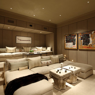 Photo of a mid-sized mediterranean enclosed home theatre in Los Angeles with carpet, beige floor and brown walls.