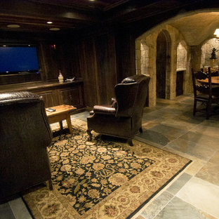 This is an example of a mid-sized traditional open concept home theatre in Boston with slate floors and a built-in media wall.