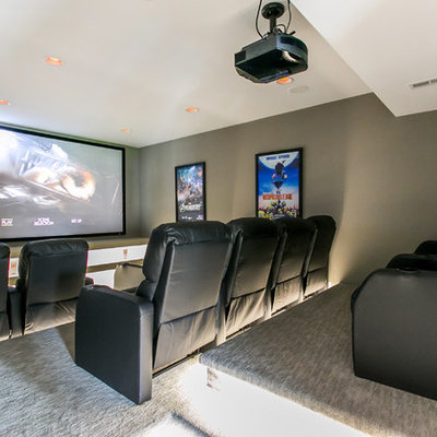 Mid-sized trendy enclosed carpeted and gray floor home theater photo in Seattle with gray walls and a projector screen