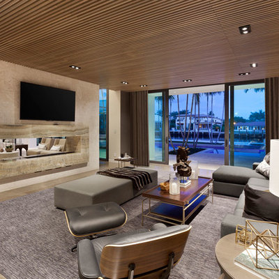 Home theater - large modern marble floor home theater idea in Miami