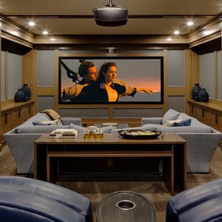 Elegant enclosed carpeted and brown floor home theater photo in Boston with multicolored walls and a projector screen