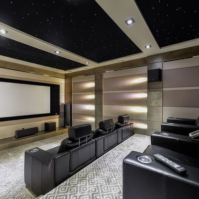 Inspiration for a large transitional enclosed carpeted and multicolored floor home theater remodel in Calgary with beige walls and a projector screen