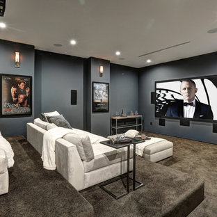 Home theater - contemporary carpeted and gray floor home theater idea in Los Angeles with gray walls