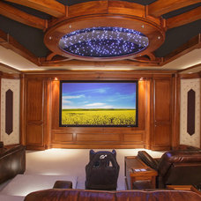 Traditional Home Theater by API Construction Ltd.