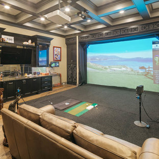 Home theater - large transitional open concept light wood floor and beige floor home theater idea in Houston with beige walls and a projector screen