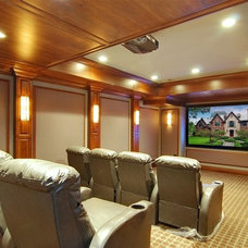 Traditional Home Theater by Heritage Luxury Builders