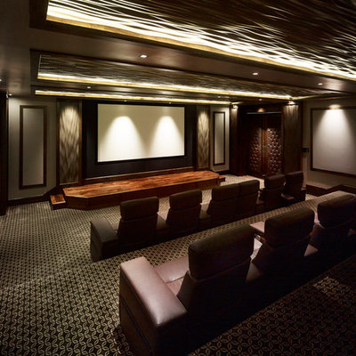 Inspiration for a huge timeless enclosed carpeted and multicolored floor home theater remodel in Salt Lake City with brown walls and a projector screen